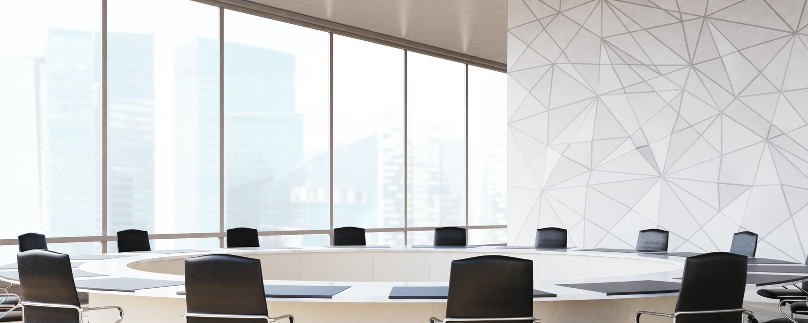 Conference Room Interior With A Round Table Black Office Chairs