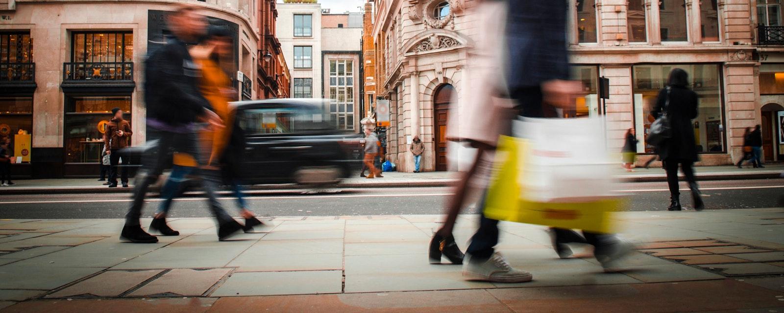 People walking along a street in London