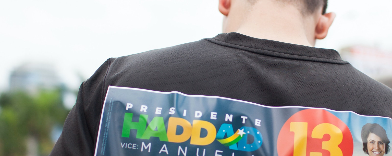 Man with Haddad's sticker on the back of his shirt