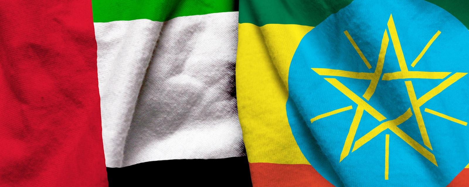 United Arab Emirates and Ethiopia flag on cloth texture