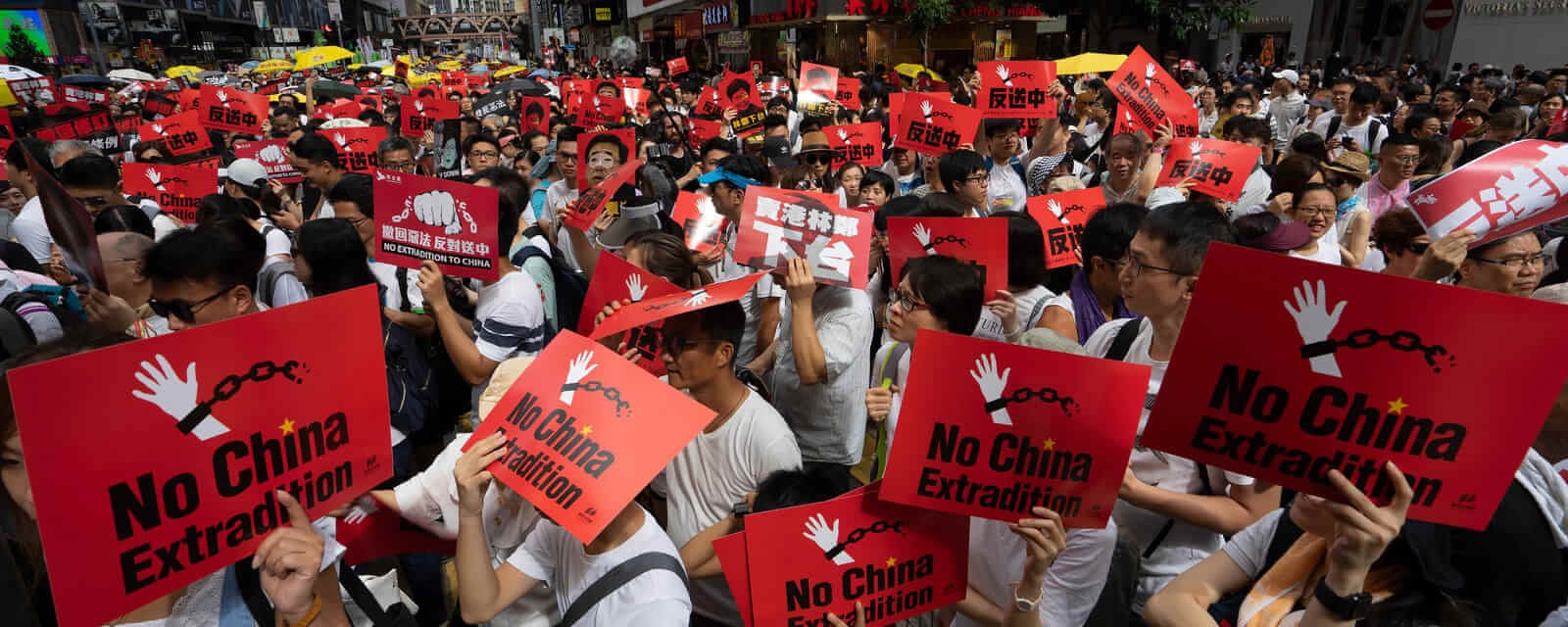 Protesters in China holding signs