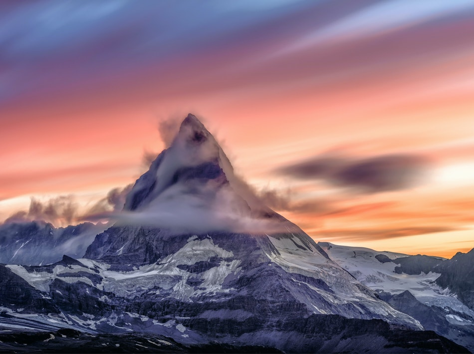 peak of a mountain and a colorful sky