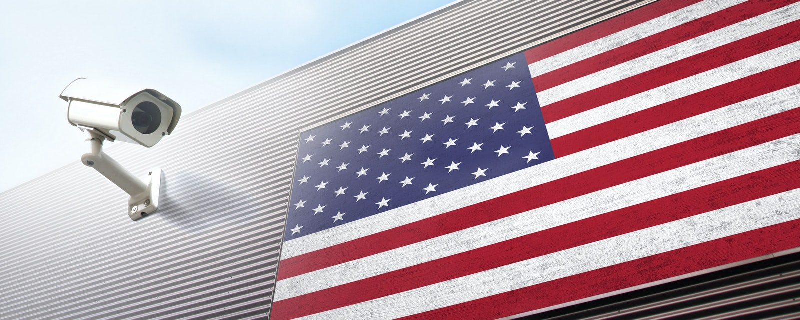 United,States,Of,America,Flag,And,Security,Camera,On,New
