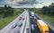 Cars,In,Motion,On,Dual,Lane,Motorway,Among,Green,Spring