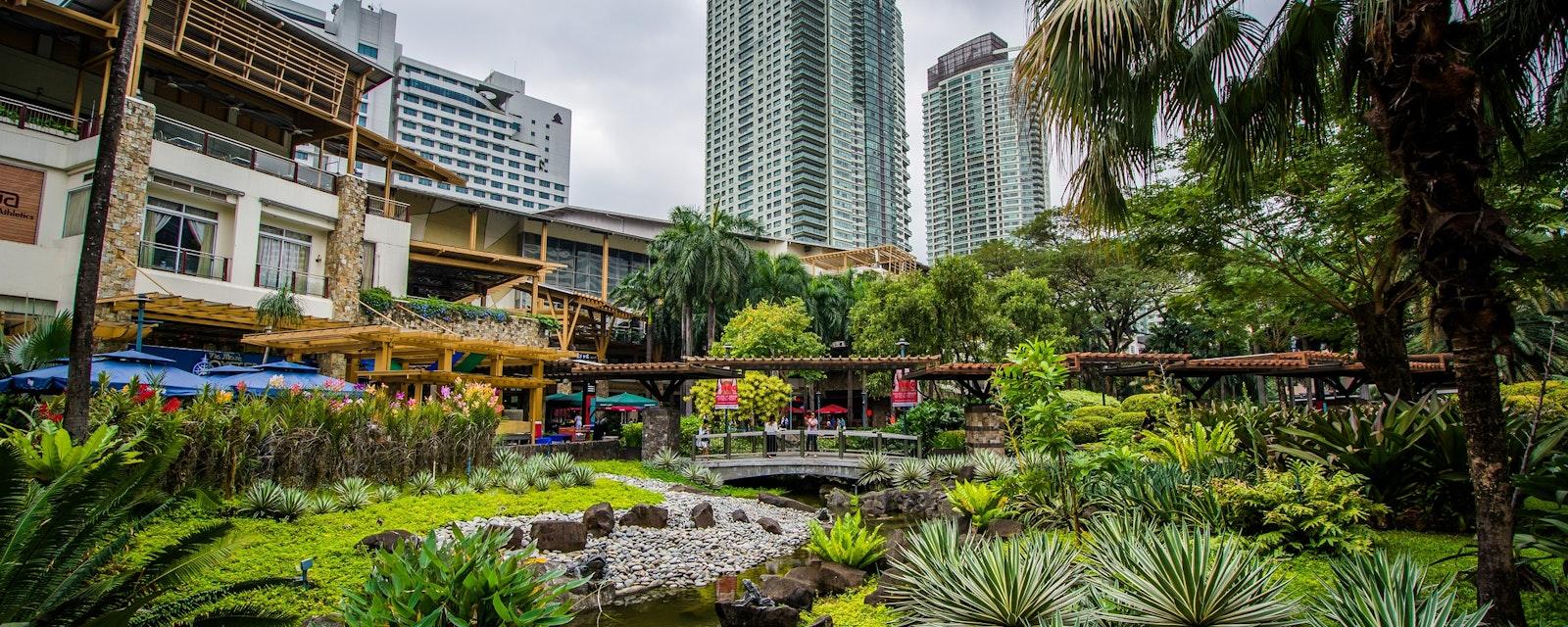 Gardens,And,Skyscrapers,At,Greenbelt,Park,,In,Ayala,,Makati,,Metro